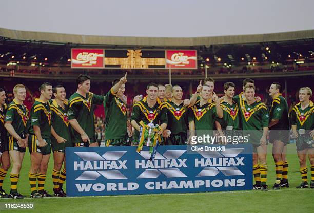 The Australian team pose with a Halifax bank sign after beating England 816 in the final of the Rugby League World Cup at Wembley Stadium London 28th...