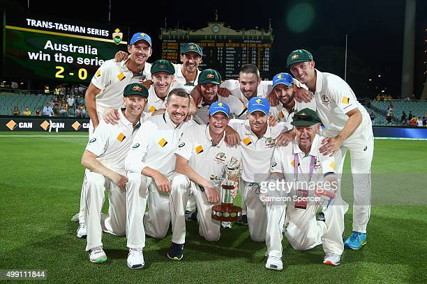 The Australian team pose with the TransTasman trophy after winning the series 20 during day three of the Third Test match between Australia and New...