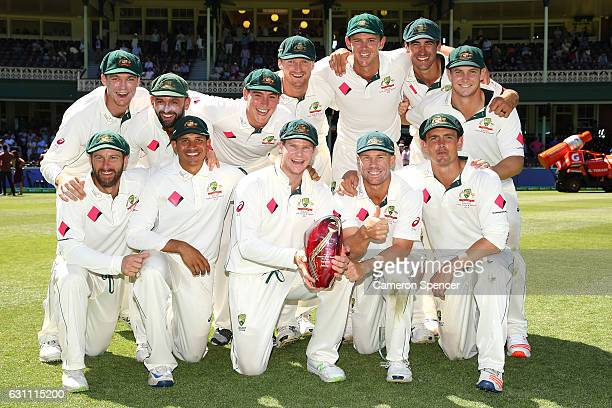 The Australian team pose with the trophy after winning the match and the series during day five of the Third Test match between Australia and...