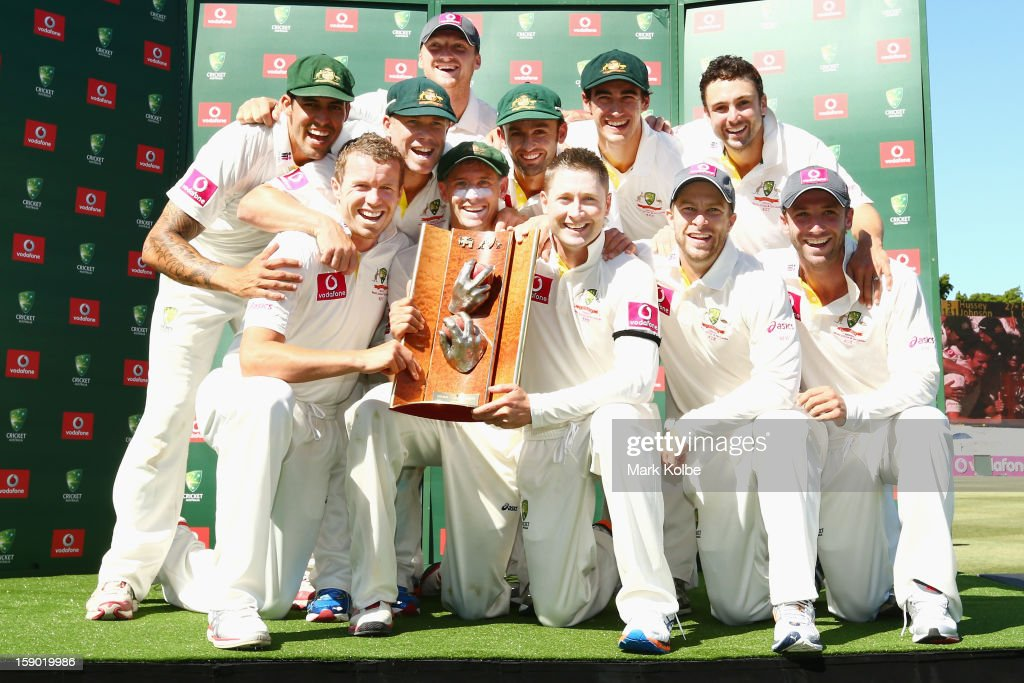 The Australian team pose with the Warne–Muralidaran trophy as they celebrate victory on day four of the Third Test match between Australia and Sri Lanka at Sydney Cricket Ground on January 6, 2013 in Sydney, Australia.