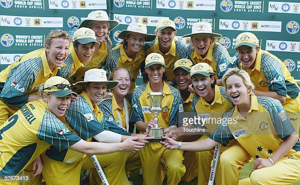 The Australian team pose with the World Cup trophy after the IWCC Women's World Cup Final match between India and Australia at Supersport Park...