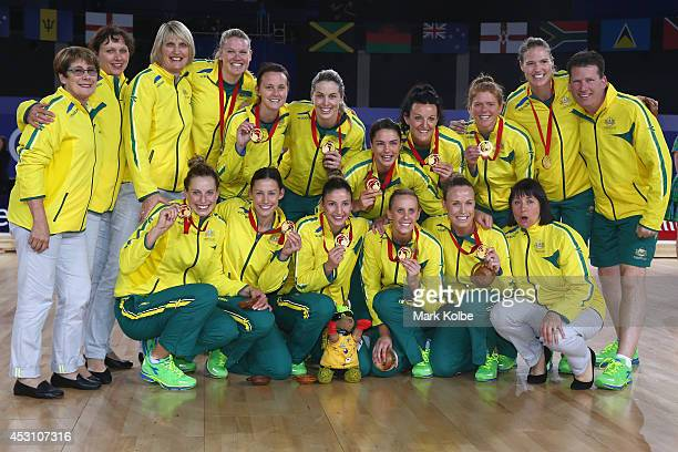 The Australian team pose with their gold medals after victory in the gold medal netball match between Australia and New Zealand at the SECC Precinct...