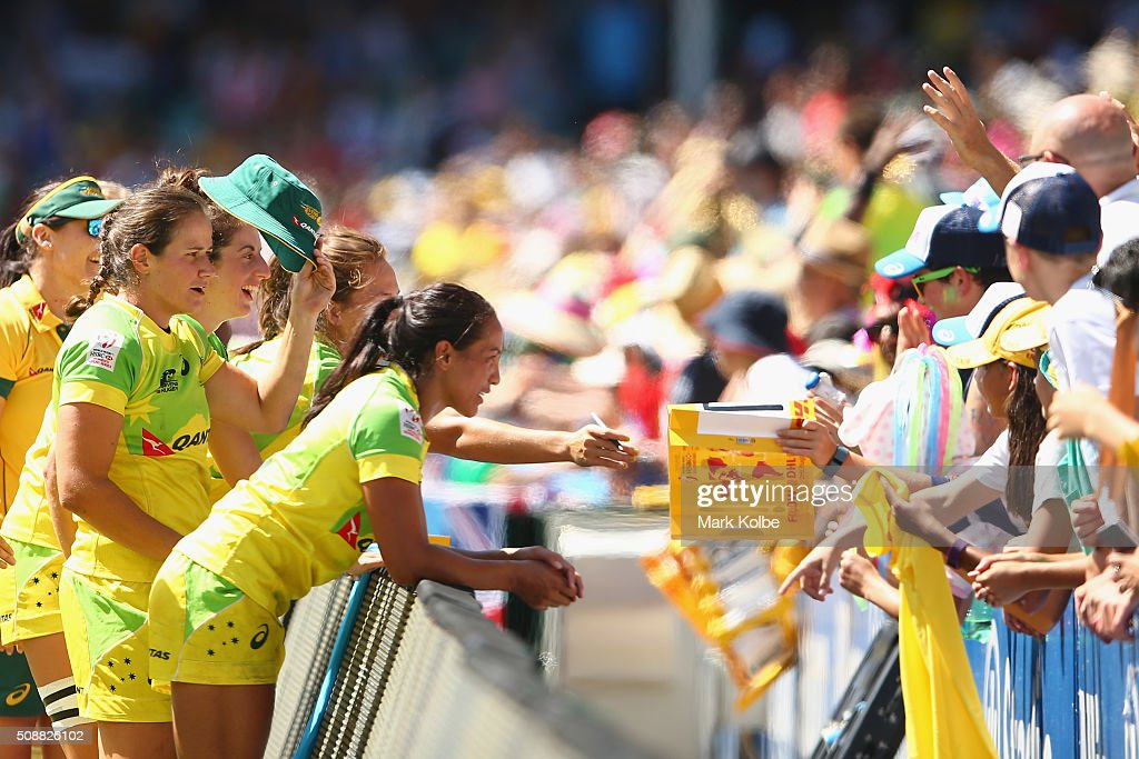 The Australian team sign autographes for the crowd after the 2016 Sydney Sevens international friendly womens match three between Australia and Ireland at Allianz Stadium on February 7, 2016 in Sydney, Australia.