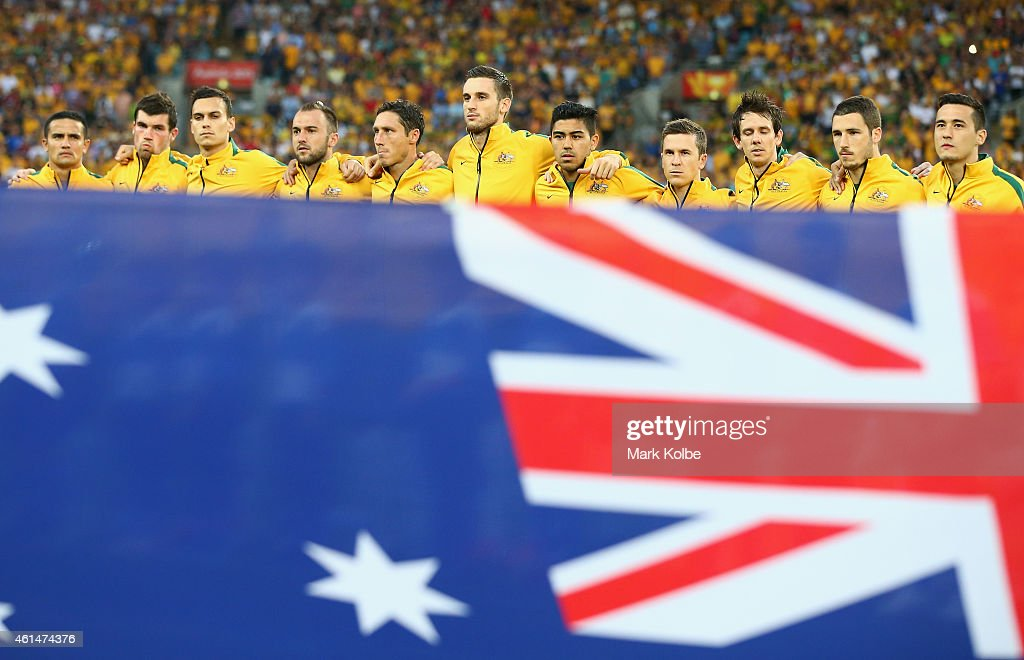 The Australian team sing the national anthem during the 2015 Asian Cup match between Oman and Australia at ANZ Stadium on January 13, 2015 in Sydney, Australia.