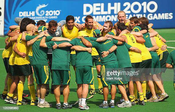 The Australian team sing their victory song after winning the Men's Gold medal match between Australia and India at the Major Dhyan Chand National...