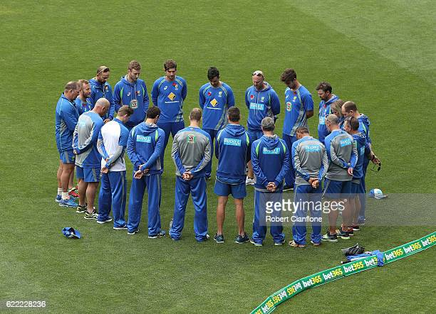 The Australian tean stand for a minutes silence for Remembrance Day during the Australian nets session at Blundstone Arena on November 11 2016 in...
