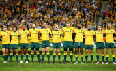 The Australian Wallabies sing the national anthem before the First International Test Match between the Australian Wallabies and France at Suncorp...
