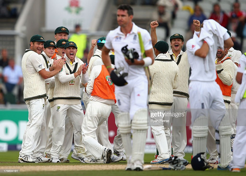 The Australians celebrate after Peter Siddle of Australia claimed the wicket of <a gi-track='captionPersonalityLinkClicked' href=/galleries/search?phrase=Kevin+Pietersen+-+Cricket+Player&family=editorial&specificpeople=202001 ng-click='$event.stopPropagation()'>Kevin Pietersen</a> of England during day five of the 3rd Investec Ashes Test match between England and Australia at Emirates Old Trafford Cricket Ground on August 5, 2013 in Manchester, England.