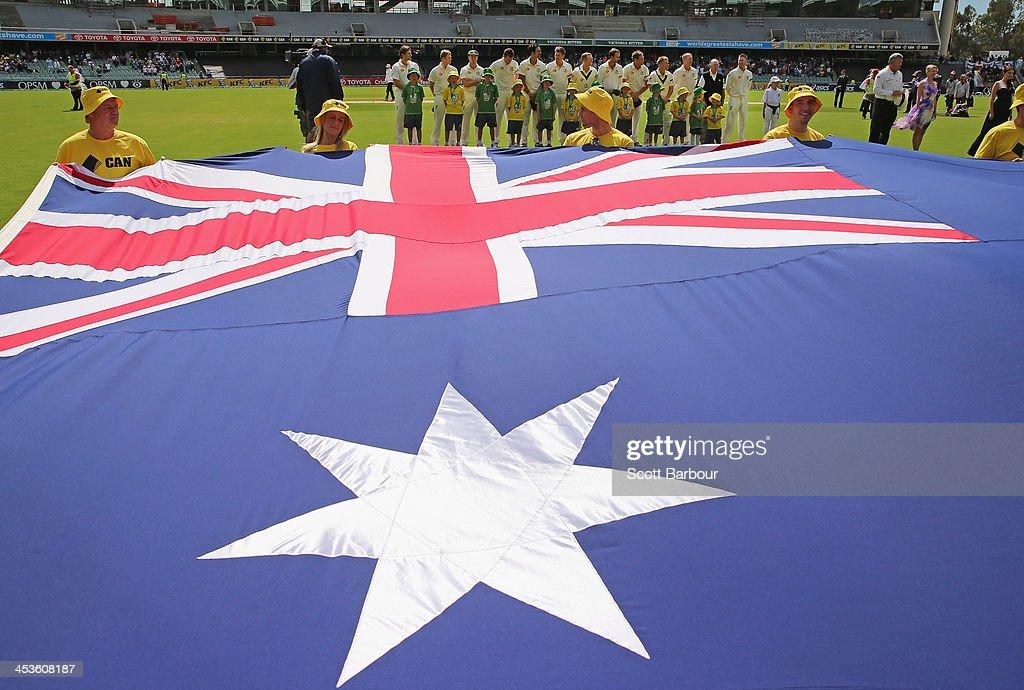 The Australians stand for the national anthems during day one of the Second Ashes Test Match between Australia and England at Adelaide Oval on December 5, 2013 in Adelaide, Australia.