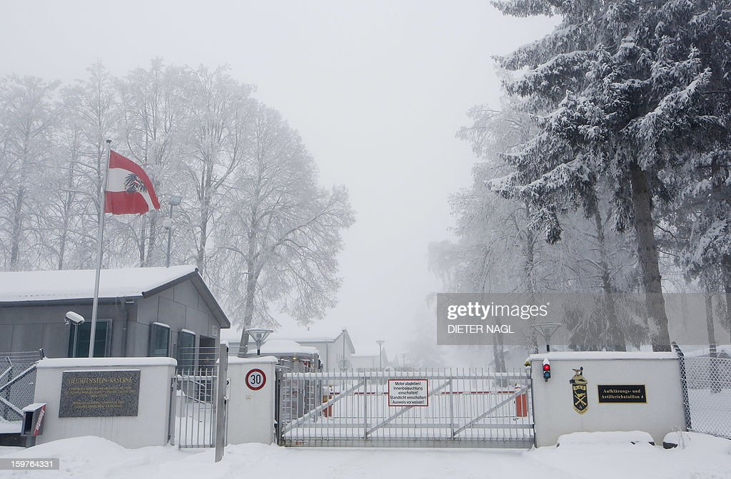 The Austrian flag is pictured at the gate of the Lichtenstein barracks in Allenstein, near Vienna, Austria on January 20, 2013. Opinion polls indicate that Austrians will decide Sunday in a referendum to remain one of the very few countries in Europe with compulsory military service.