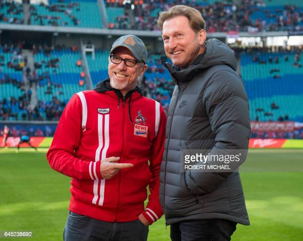 The Austrian head coaches of Cologne Peter Stoeger and Leipzig Ralph Hasenhuettl chat prior the German first division Bundesliga football match...