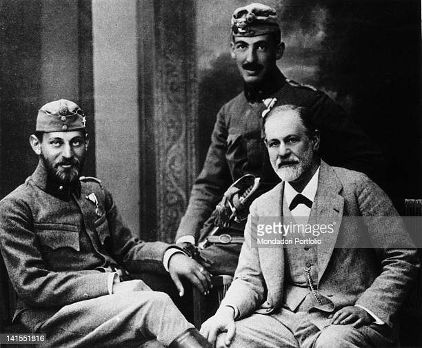 The Austrian psychoanalyst Sigmund Freud posing with his sons Ernst and Martin in military uniform Austria 1916