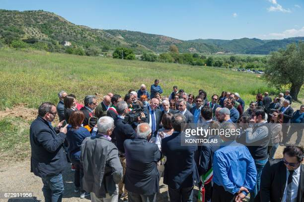 The authorities on the site where the cemetery will be built during the official presentation of the project of the 'Cemetery memorial for migrants...