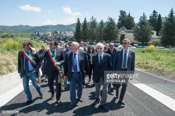 The authorities with the center Mario Oliverio President of the Region Calabria to his right the mayor of Tarsia Roberto Ameruso and to his left...