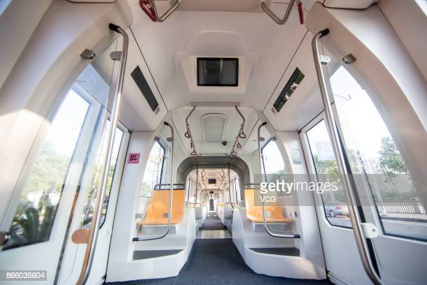 The autonomousrail train is pictured during its test run on October 23 2017 in Zhuzhou Hunan Province of China The threecarriage railless train...