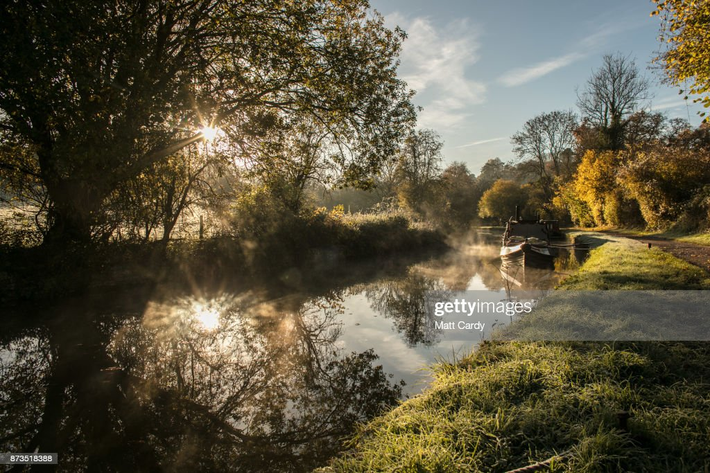 The autumn colours are reflected in the water of the Kennet and Avon canal near Limpley Stoke as the sun rises on November 13, 2017 near Bath, England. After a warm autumn, with temperatures above average, much colder weather has arrived in many parts of the UK, signalling the start of more wintery weather for the coming few weeks.