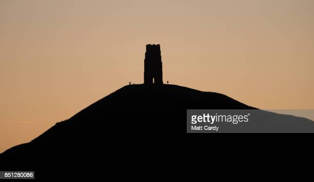The autumn sun begins to rises over Glastonbury Tor near Glastonbury on September 22 2017 in Somerset England Today marks the start of the...