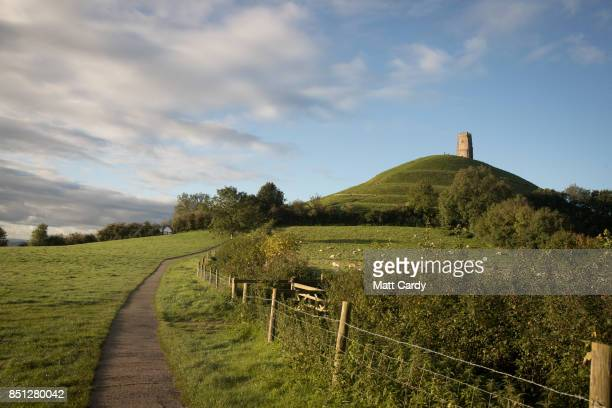 The autumn sun shines onto Glastonbury Tor near Glastonbury on September 22 2017 in Somerset England Today marks the start of the astronomical autumn...