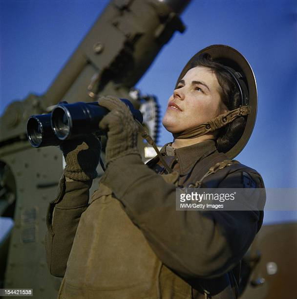 The Auxiliary Territorial Service At An AntiAircraft Gun Site In Britain December 1942 An ATS spotter with binoculars at the antiaircraft command...