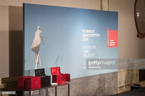 The awards and the official poster of the 15th Biennale of Architecture are seen at the official opening ceremony on May 28 2016 in Venice Italy The...