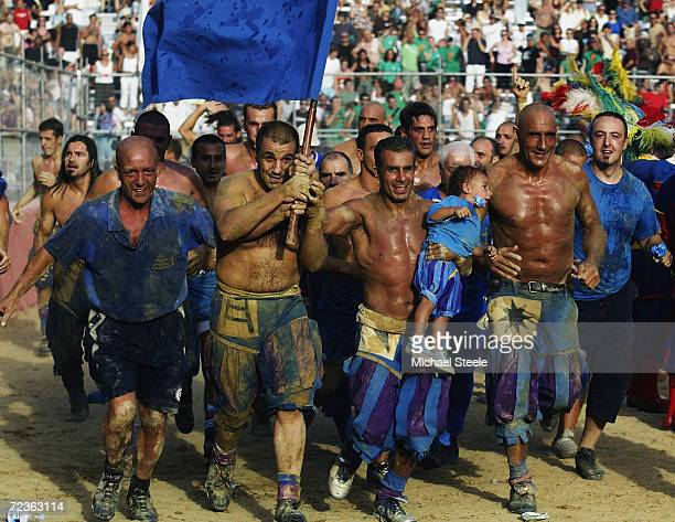The Azzurri team celebrate their victory during the Calcio Storico a medieval football rules event held between four quarters of Florence since 1584...