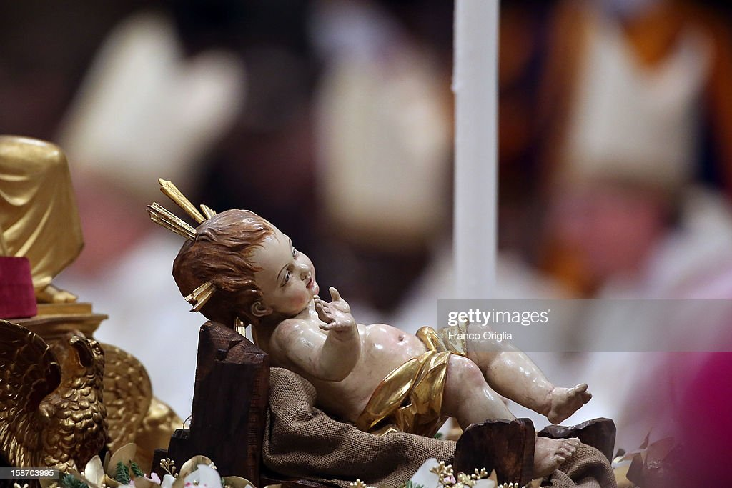 The baby Jesus is seen in the Nativity during the Christmas night mass held by Pope Benedict XVI at the St. Peter's Basilica on December 24, 2012 in Vatican City, Vatican.