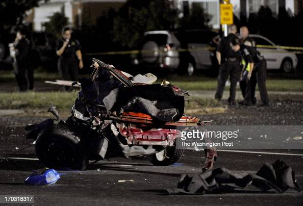 The back end of a car that was torn in half lies in the road on Georgia Ave after a fatal 3vehicle crash that killed a total of 3 people The...
