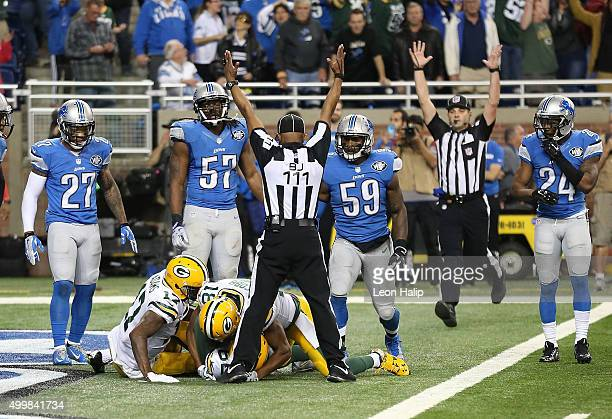 The back judge Terrence Miles signals the touchdown good after Richard Rodgers of the Green Bay Packers catches a 61 yard pass to win the game 2723...