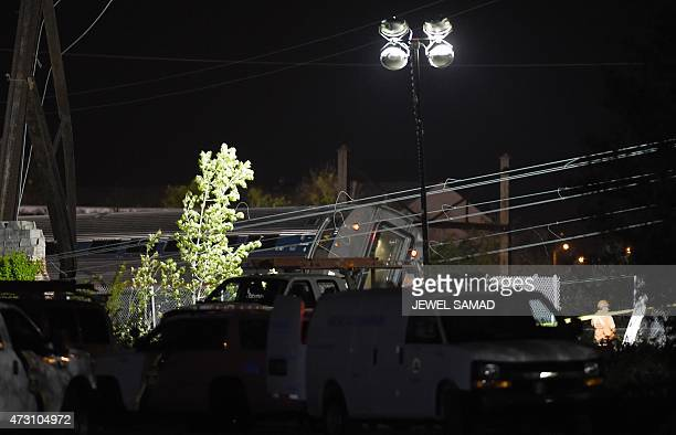 The back of a derailed train carriage is seen in Philadelphia Pennsylvania on May 13 2015 At least five people were killed and dozens injured after...