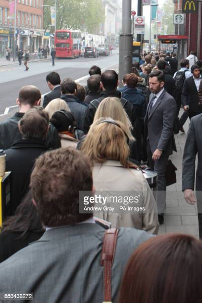The back of a long queue for a bus outside Waterloo station London on the second day of a 48 hour strike by tube workers on the London Underground...