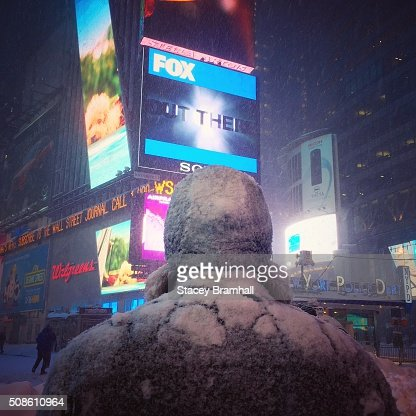 The back of a man covered in snow in Times Square during the 2016 blizzard : Stock Photo