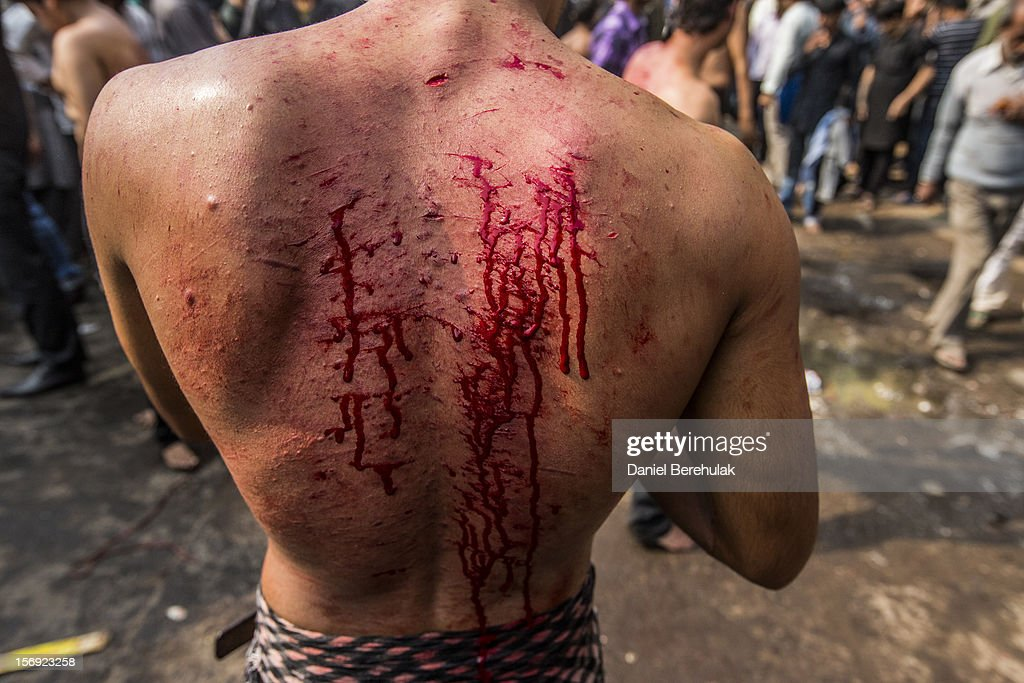 The back of a Shiite muslim man is covered in bloodied cuts after having self-flagellated during a religious procession marking Ashura on November 25, 2012 in New Delhi, India. The religious festival of Ashura, which involves a ten-day mourning period starting with the first day of Muharram on the Islamic calendar, commemorates and mourns the seventh-century martyrdom of Prophet Muhammad's grandson Imam Hussein in the battle of Karbala.
