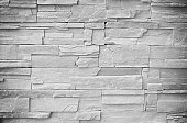 The background of the brick  white, gray, and black.colors horizontally, which is beautiful.