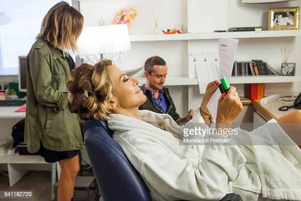 Italian TV presenter Barbara D'Urso relaxing in the dressing room and reading the treatment with the authors Photo shooting Cologno Monzese 19th...