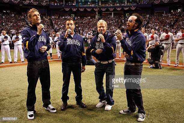 The Backstreet Boys peform the National Anthem before game one of the 2008 MLB World Series between the Philadelphia Phillies and theTampa Bay Rays...