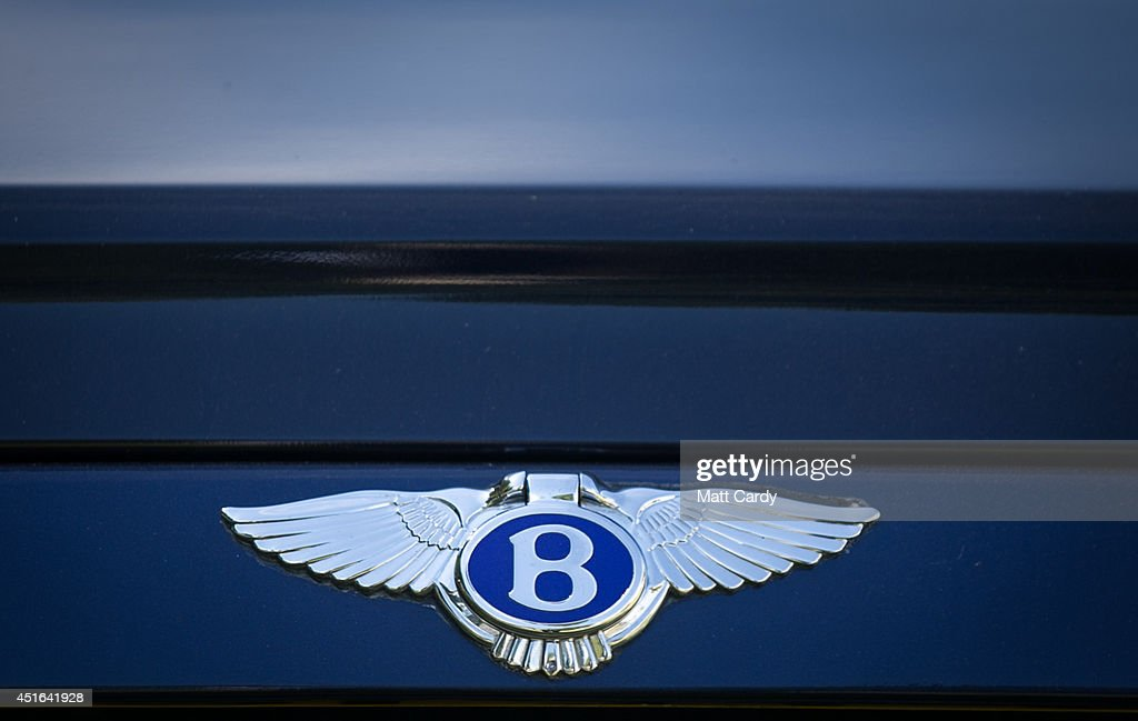 The badge of a Bentley is seen in the car park at the Henley Royal Regatta on July 3, 2014 in Henley-on-Thames, England. Opening today and celebrating its 175th year, the Henley Royal Regatta is regarded as part of the English social season and is held annually over five days on the River Thames. Thousands of rowing fans are expected to come to watch races which are head-to-head knock out competitions, raced over a course of 1 mile, 550 yards (2,112 m) which regularly attracts international crews to race.