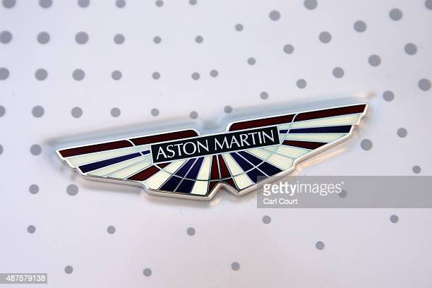 The badge of an Aston Martin car is pictured ahead of a photocall with executives from car manufacturing companies on September 10 2015 in London...