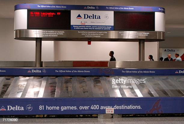The baggage carousel at Atlanta HartsfieldJackson International Airport lies quiet for Comair Flight 1066 from Lexington Kentucky the flight that was...