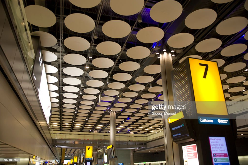The baggage hall at the new Heathrow Terminal 5 building This controversial new airport designed by star architect Richard Rogers was built at a cost...