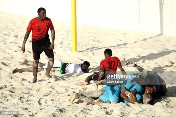 The Bahamas celebrate a late goal which secured them victory during the boy's beach soccer bronze medal final match between Antigua the Bahamas on...