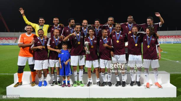 The Bahrain FA team with FIFA Legends Pablo Aimar and Alexei Smertin celebrates victory in the FIFA Football Tournament at the Bahrain National...