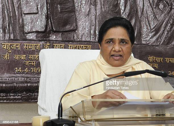 The Bahujan Samaj Party Chief Mayawati addressing a press conference on remark by RSS Head Mohan Bhagwat on reservation at her residence on Tyagraj...