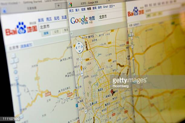 The Baidu Inc and Google Inc websites display a map of Beijing arranged on a computer screen in Beijing China on Tuesday March 30 2011 Google Inc's...