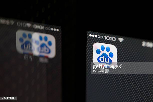 The Baidu Inc application icon displayed on an Apple Inc iPhone 5s smartphone is reflected on a surface in an arranged photograph in Hong Kong China...