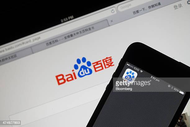 The Baidu Inc application icon is displayed on an Apple Inc iPhone 5s smartphone on top of an iPad device displaying the Baidu search engine website...