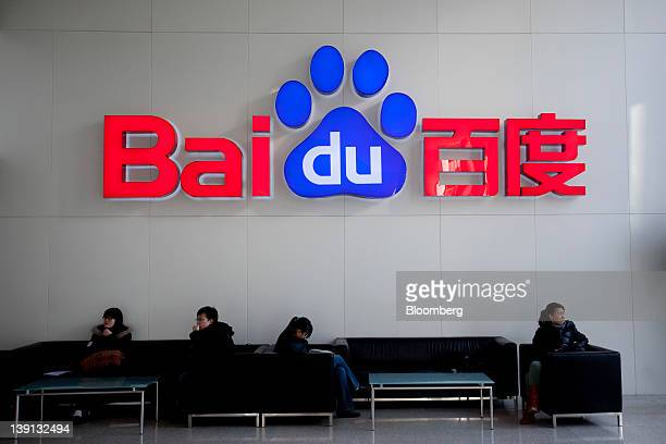 The Baidu Inc logo hangs in the lobby of the company's headquarters in Beijing China on Friday Feb 17 2012 Baidu owner of China's dominant search...