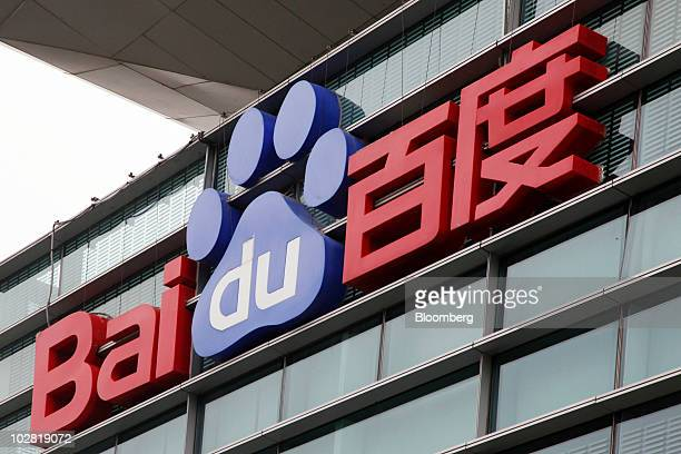 The Baidu Inc logo hangs outside the company's office in Shanghai China on Monday July 12 2010 After winning permission from China's government to...