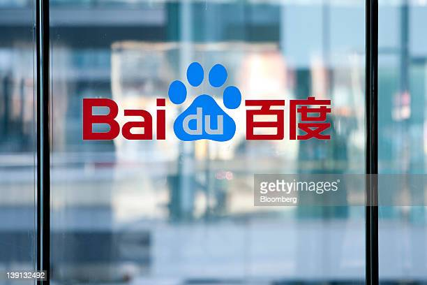 The Baidu Inc logo is displayed on a window at the company's headquarters in Beijing China on Friday Feb 17 2012 Baidu owner of China's dominant...