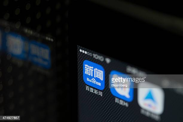 The Baidu Inc News search engine application icon from left and Baidu Hi instant messaging application icon displayed on an Apple Inc iPhone 5s...