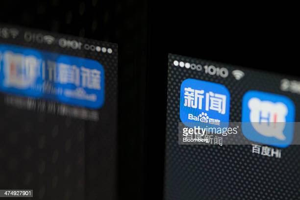 The Baidu Inc News search engine application icon left and Baidu Hi instant messaging application icon displayed on an Apple Inc iPhone 5s smartphone...